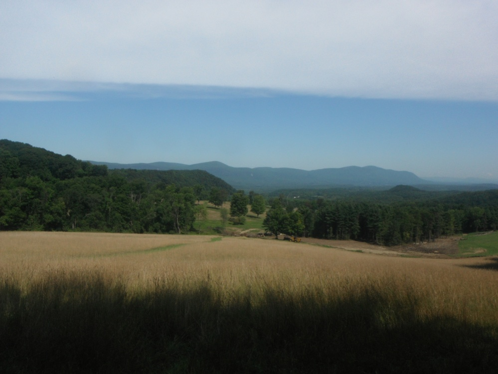 The rolling hills and blue sky of southern New England