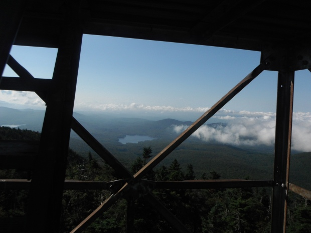 A view of lakes and mountains from a fire tower