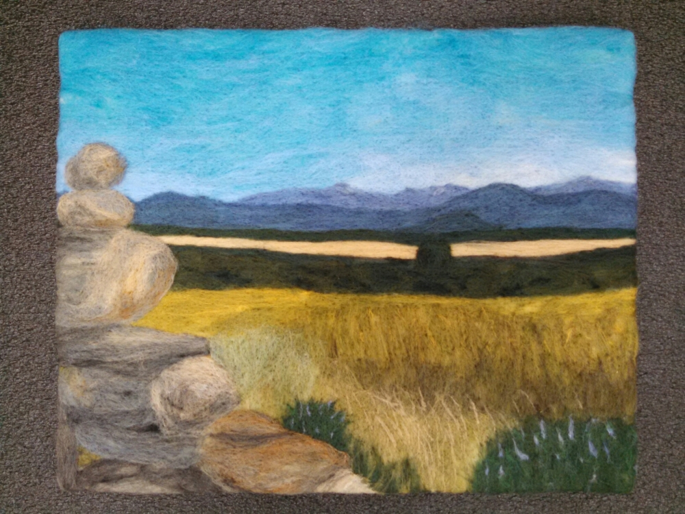 A felted wool painting of the valley of the Rio Aragones