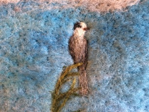 A needle-felted gray jay